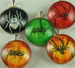 Glass pendants featuring various creepy crawlies