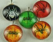 Glass pendants featuring various creepy crawlies